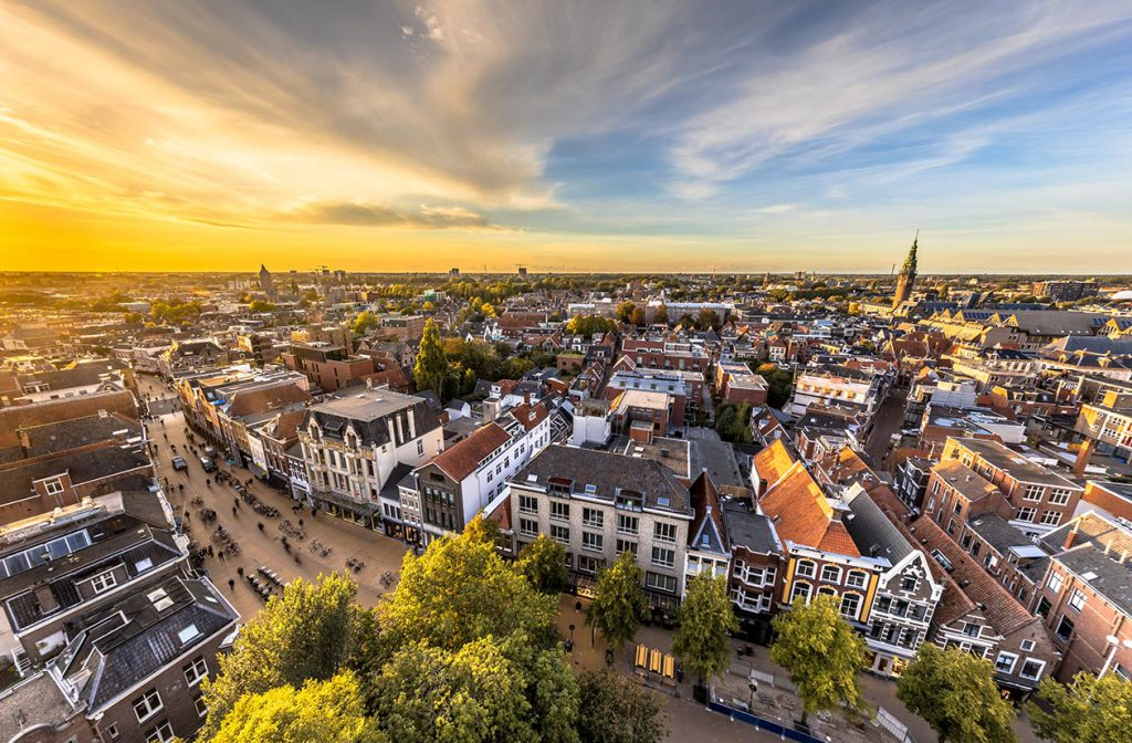 drone shot of Amsterdam with the sun setting