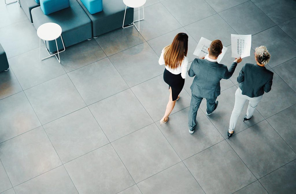 people walking in a global expansion workplace